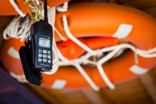 Mobile phone tied with rope to life preserver